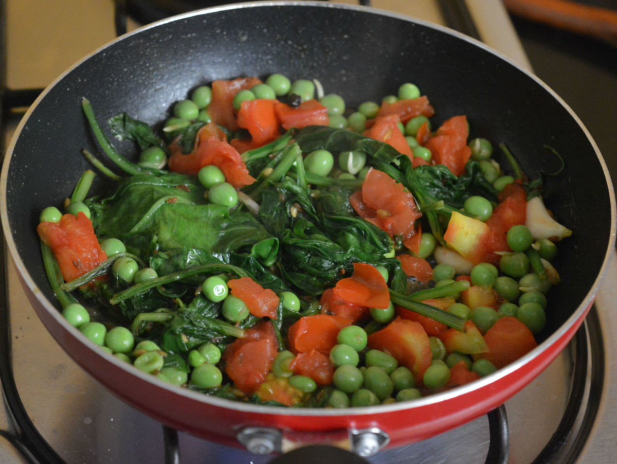 Step four: Add fresh peas and chopped tomatoes. Stir-cook on a high heat till tomatoes become a bit mushy. Turn off the heat.
