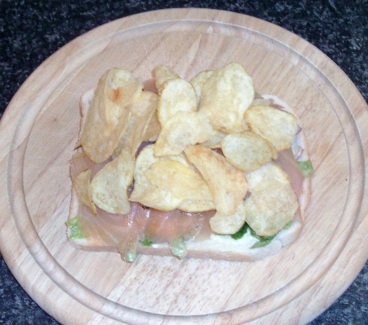 Crisps are arranged on smoked salmon