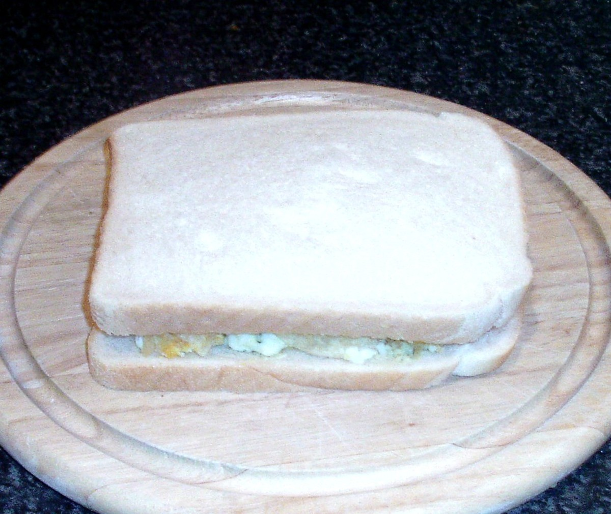 Top slice of bread is laid in place