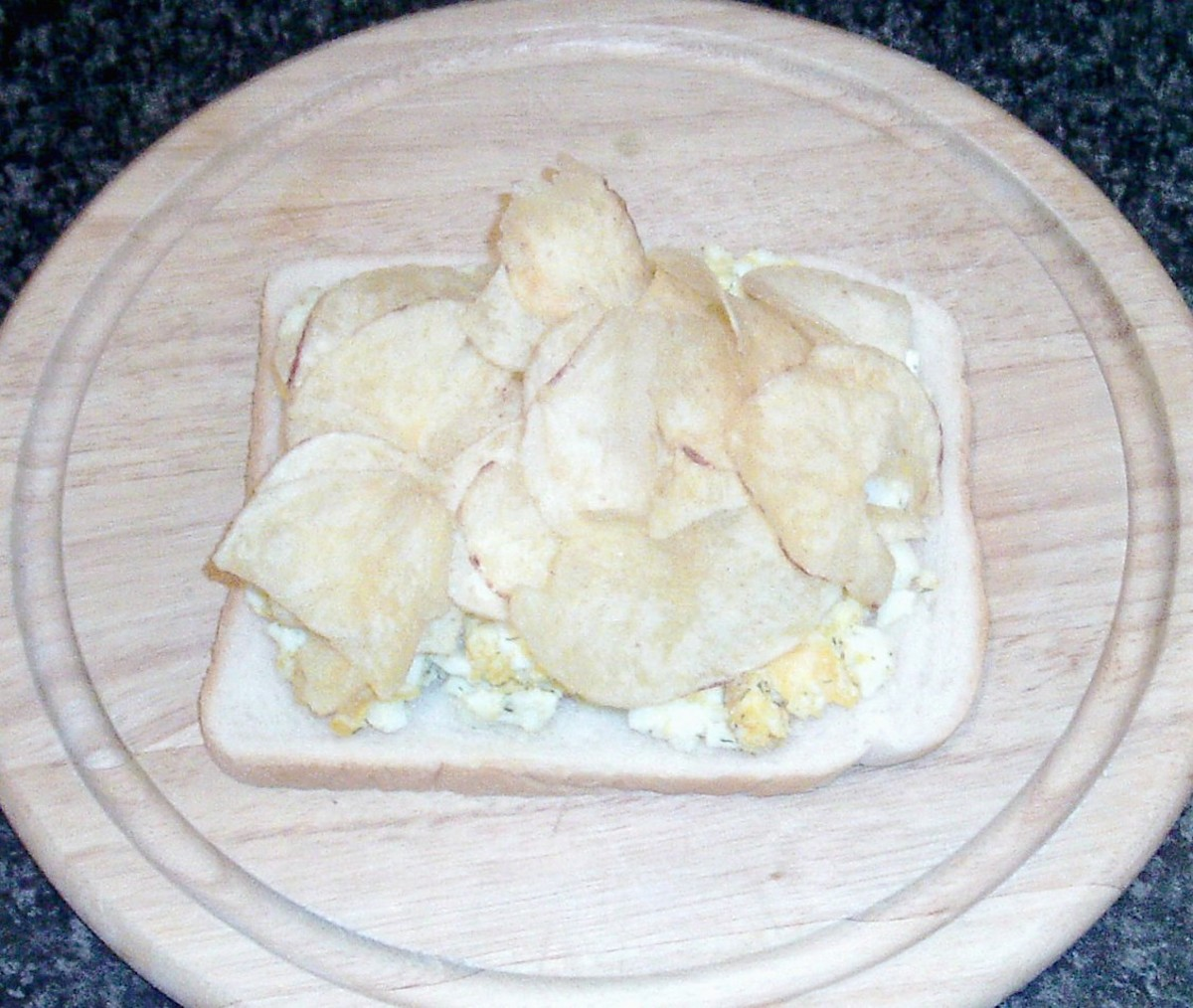 Crisps arranged on top of egg