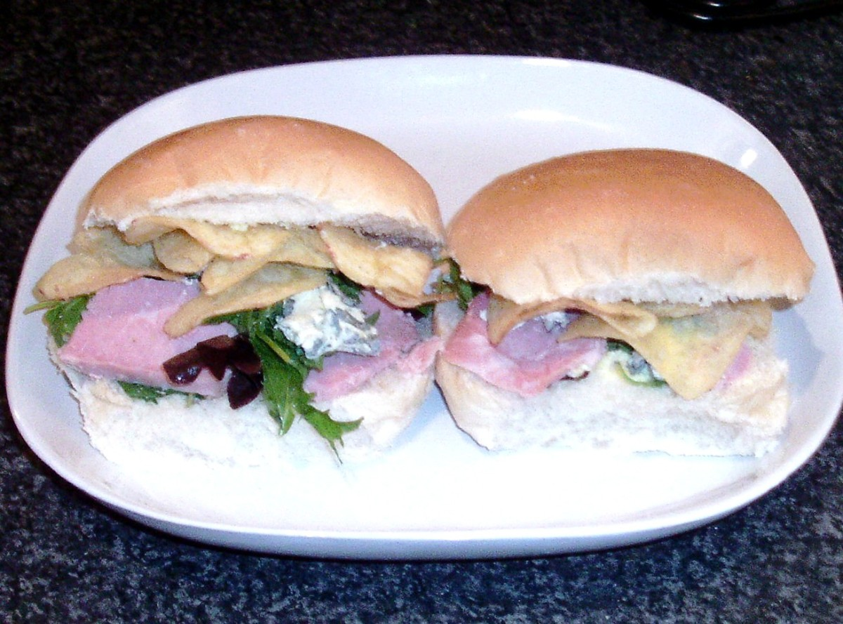 Cold roast ham, blue cheese and mixed leaf salad with crisps on bread rolls