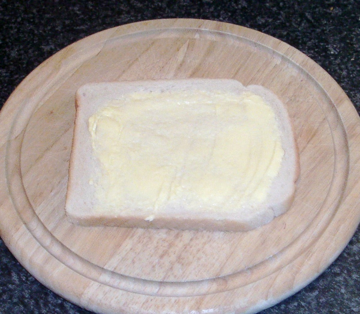 Butter is spread on bread