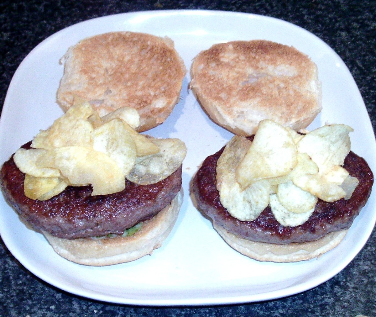 Crisps are arranged on top of venison grillsteaks