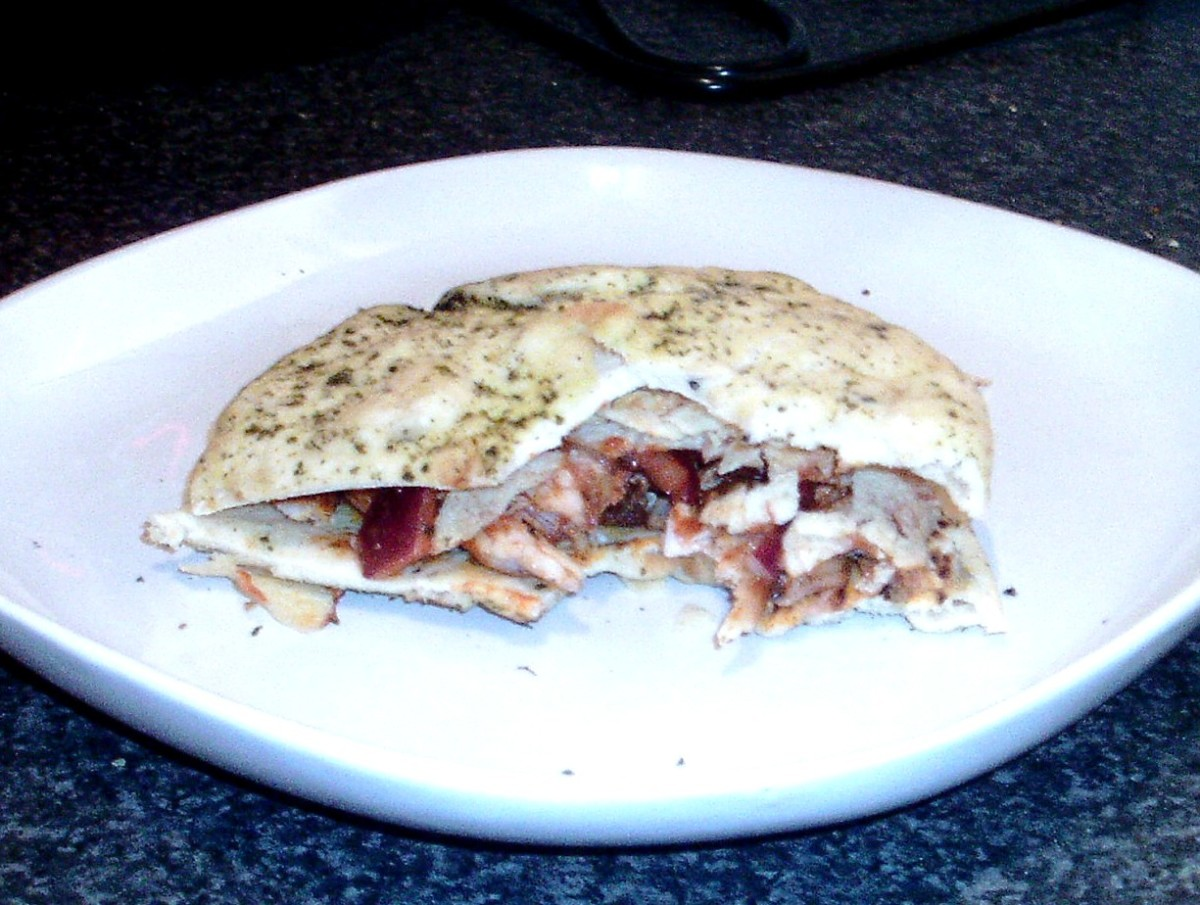 Chilli spiced baked chicken, Indian spiced onions and ready salted crisps naan sandwich