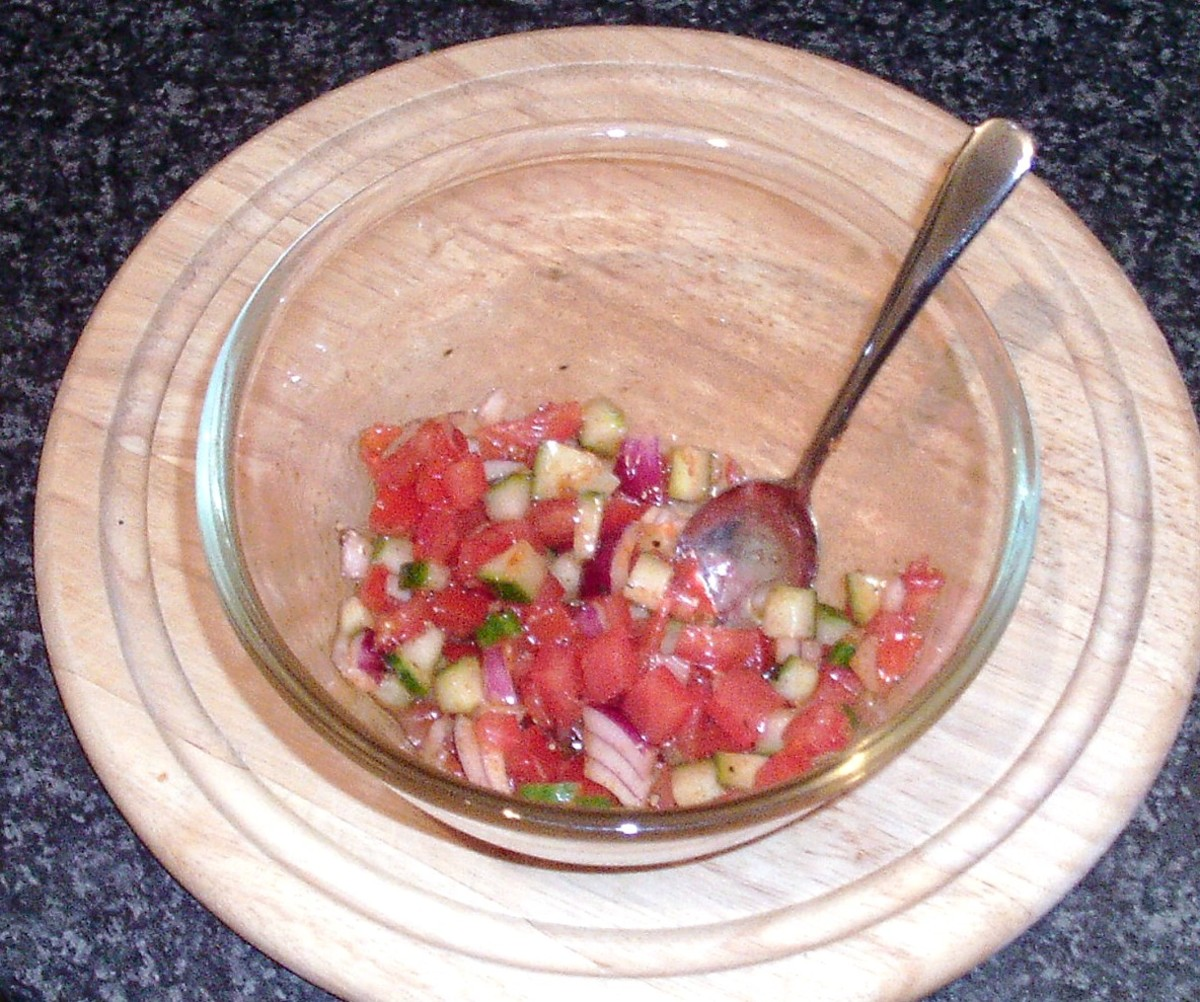 Salsa ingredients are carefully stirred together
