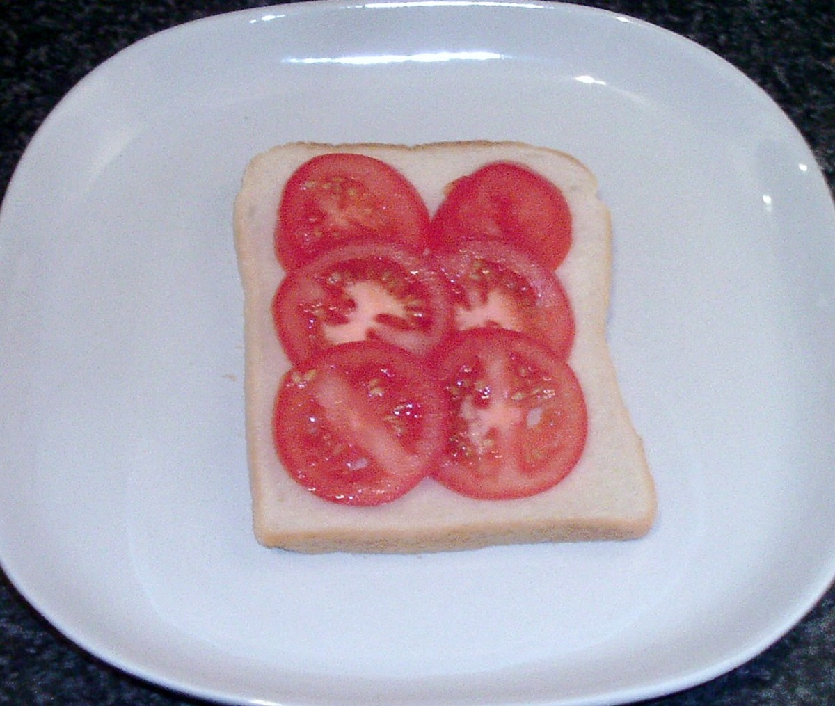 Tomato slices laid on bread