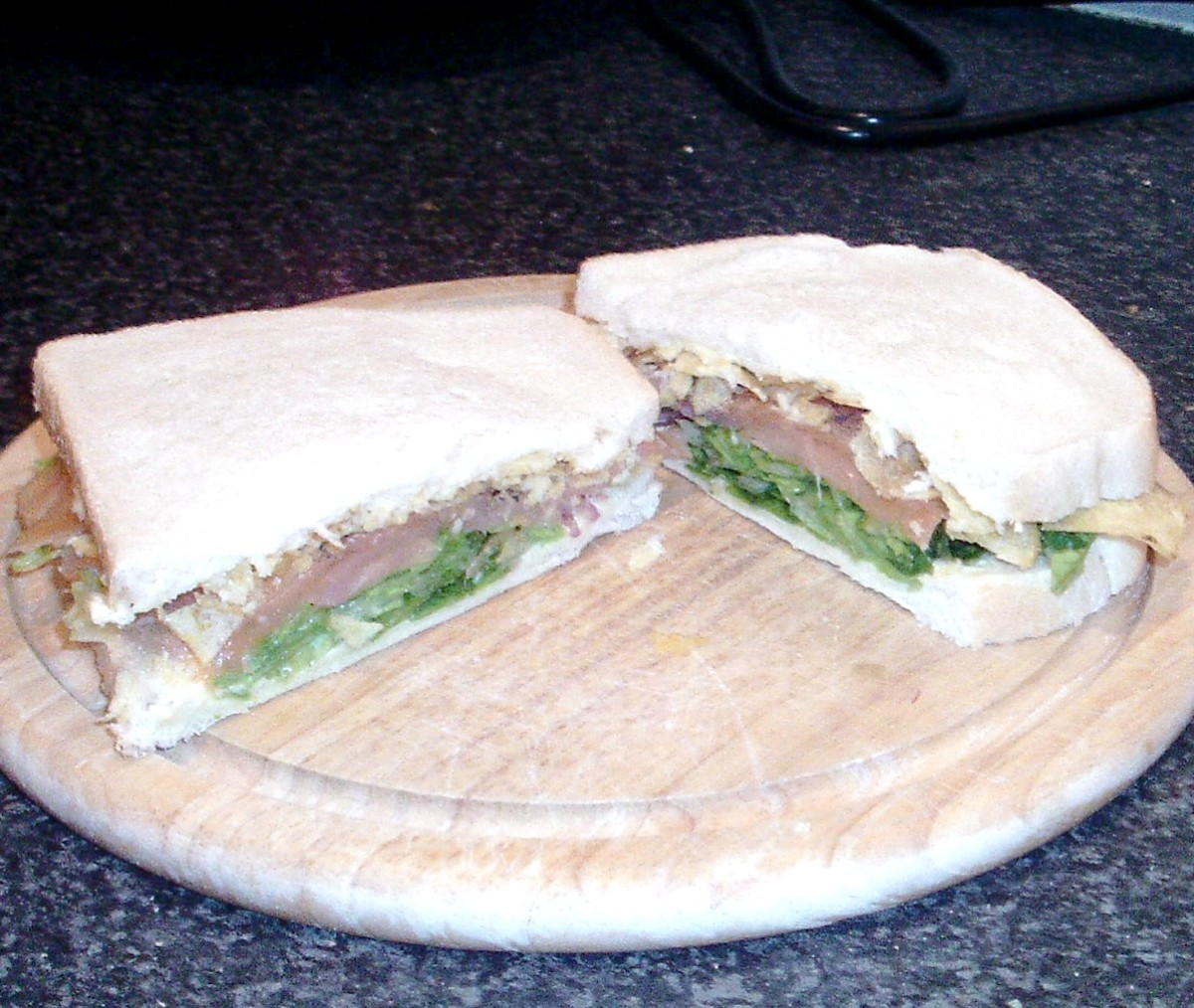Smoked salmon, balsamic seasoned salad and crisps sandwich