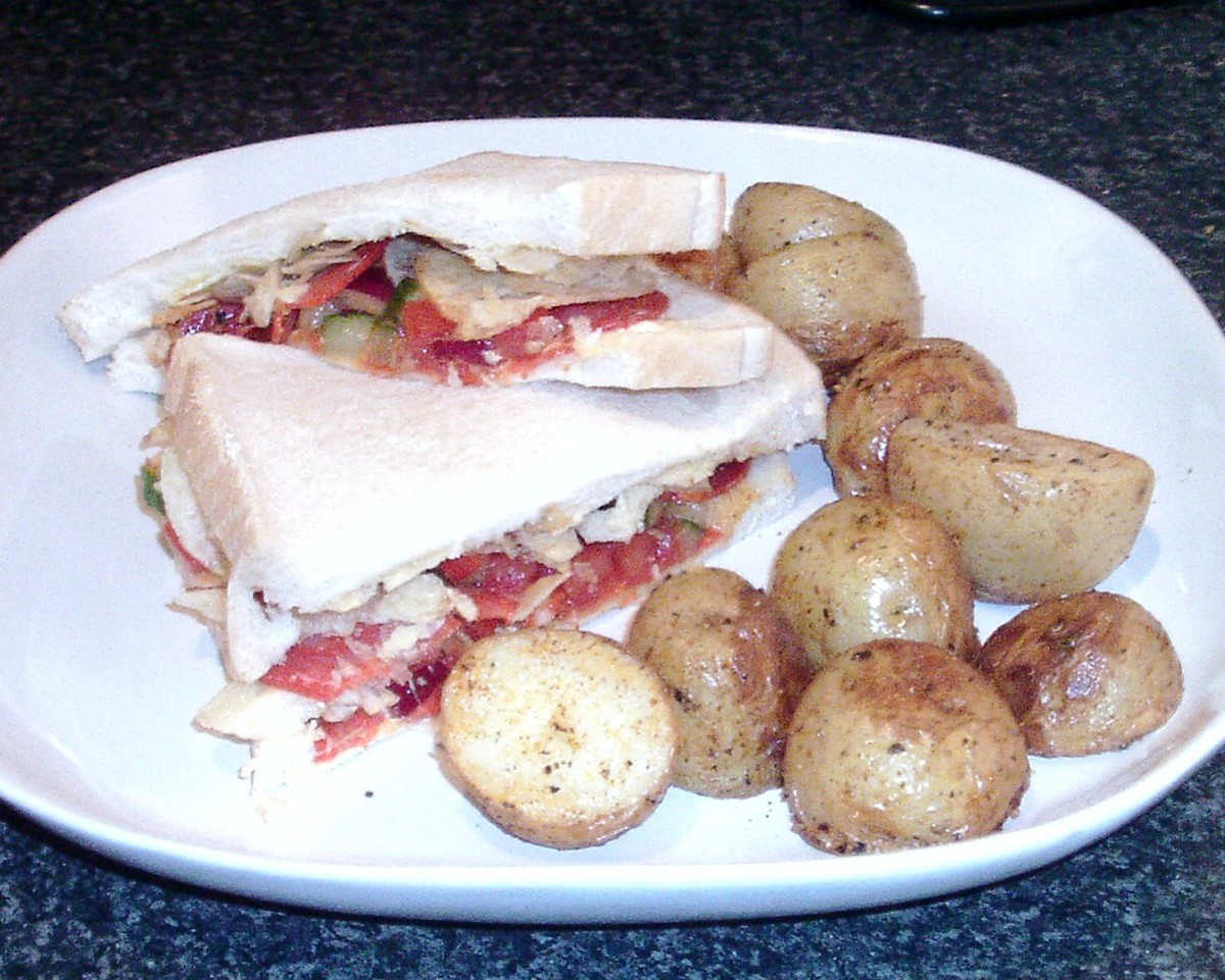 Chorizo, salsa and ready salted crisp sandwich with paprika spiced roast potatoes