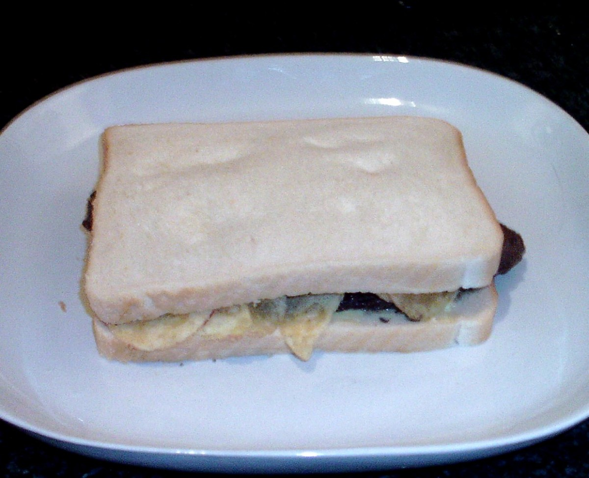 Second slice of bread completes assembly of steak and crisp sandwich