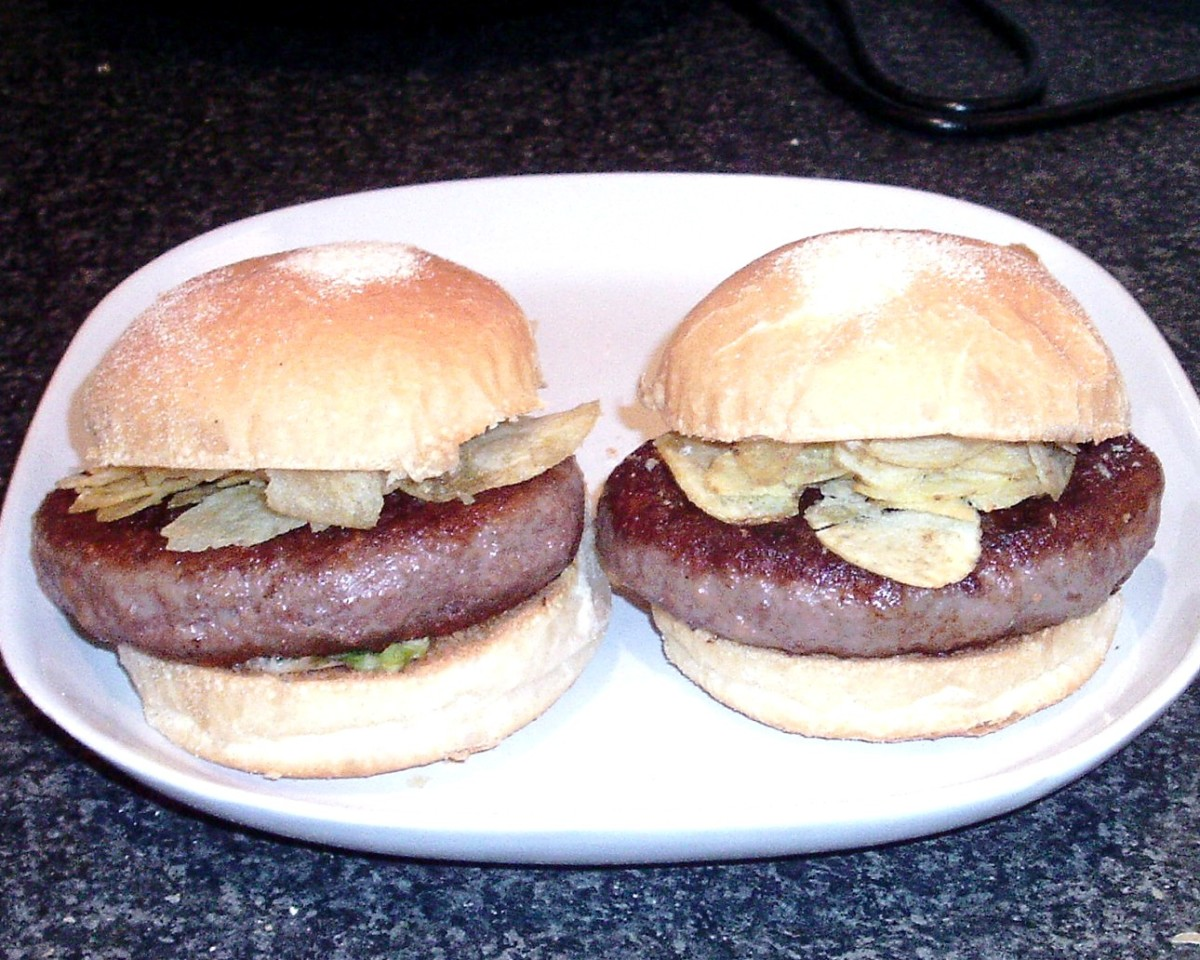 Venison grillsteaks on soft bread rolls with redcurrant sauce dressed salad and ready salted crisps