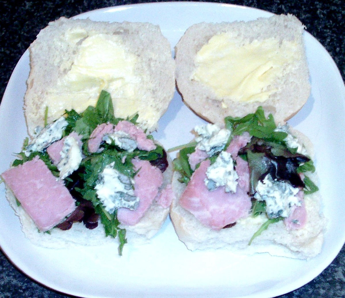 Ham, blue cheese and mixed leaf salad on rolls
