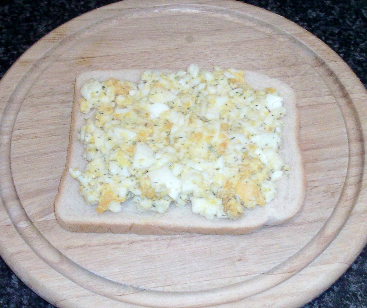 Mashed egg is spread on bread