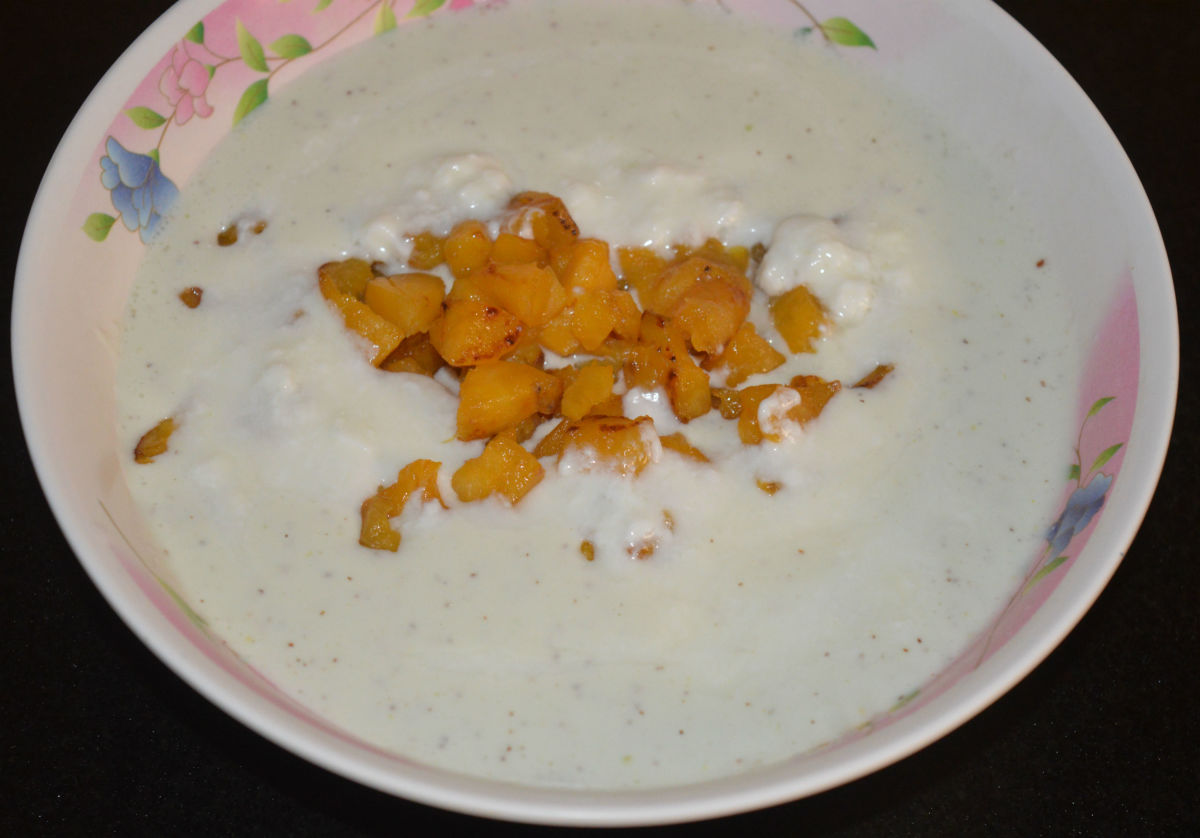 Step five: Transfer the paste to a bowl. Add remaining yogurt and sauteed plantains. Mix well. This is the raita.