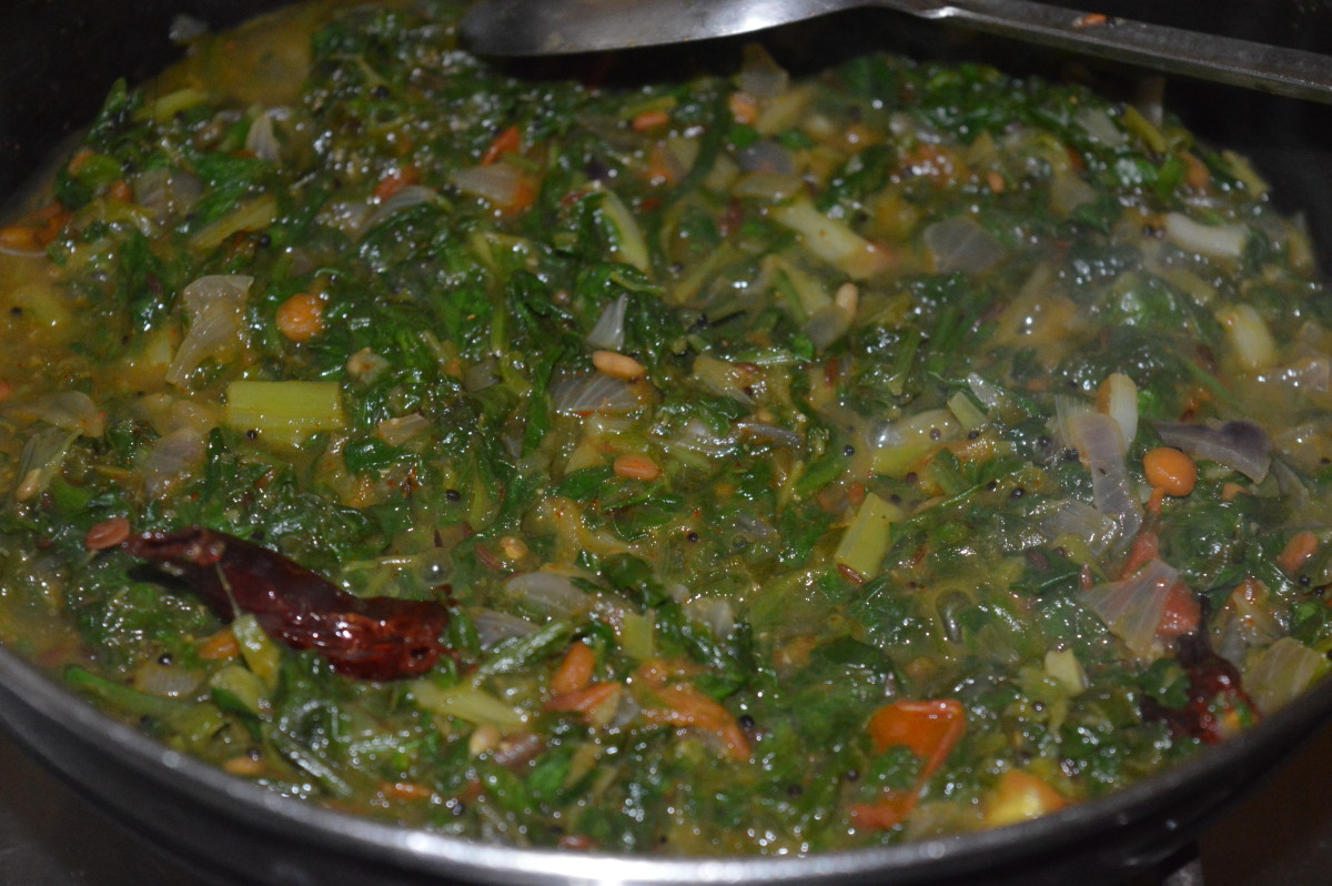 Step seven: Add two cups of water. Stir well. Cook till the veggies become soft and combine well. Simmer until the curry gets a soft texture. Add remaining salt. Mix well. Turn off the stove.