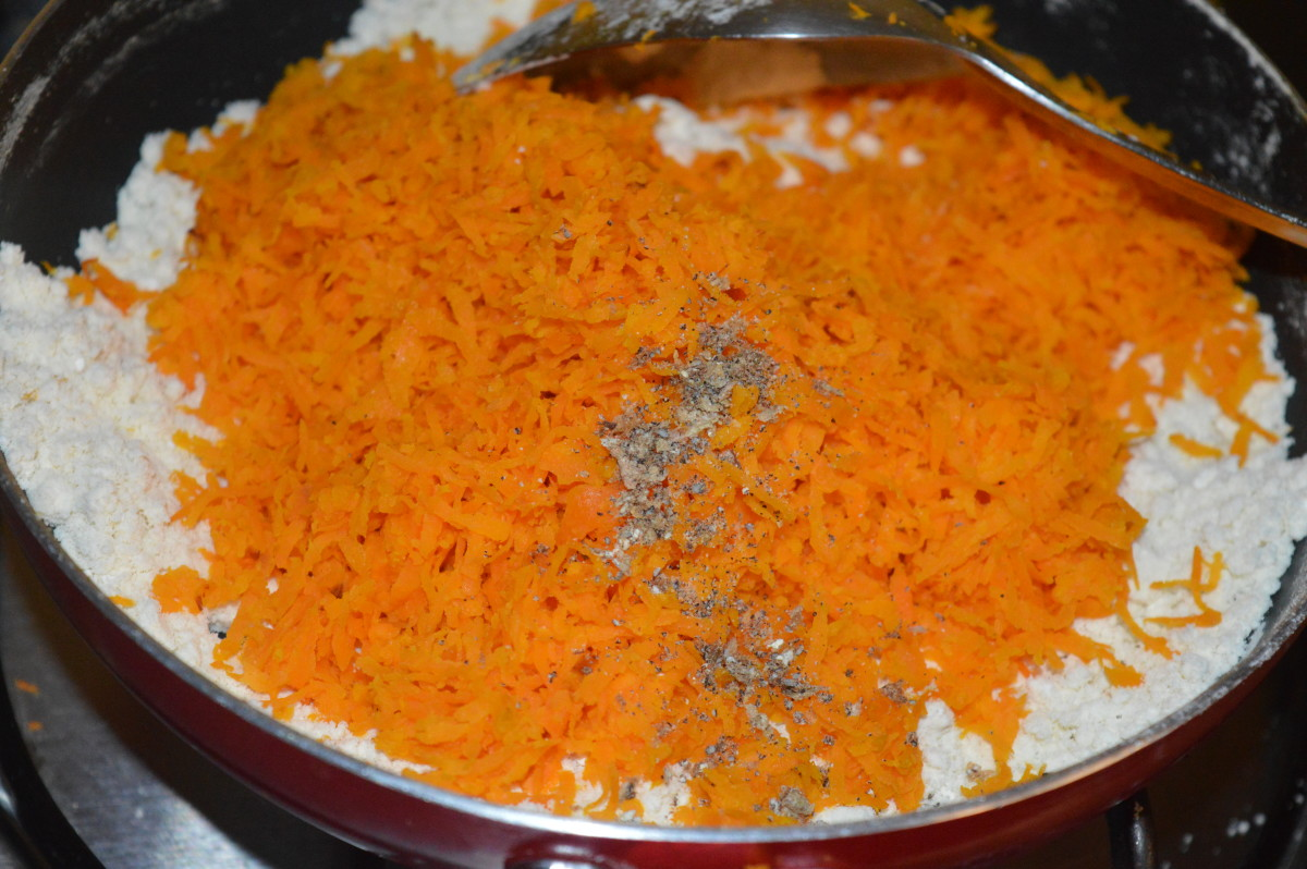 Step four: Add sauteed carrot, crushed cardamom, and remaining ghee. Mix very well.