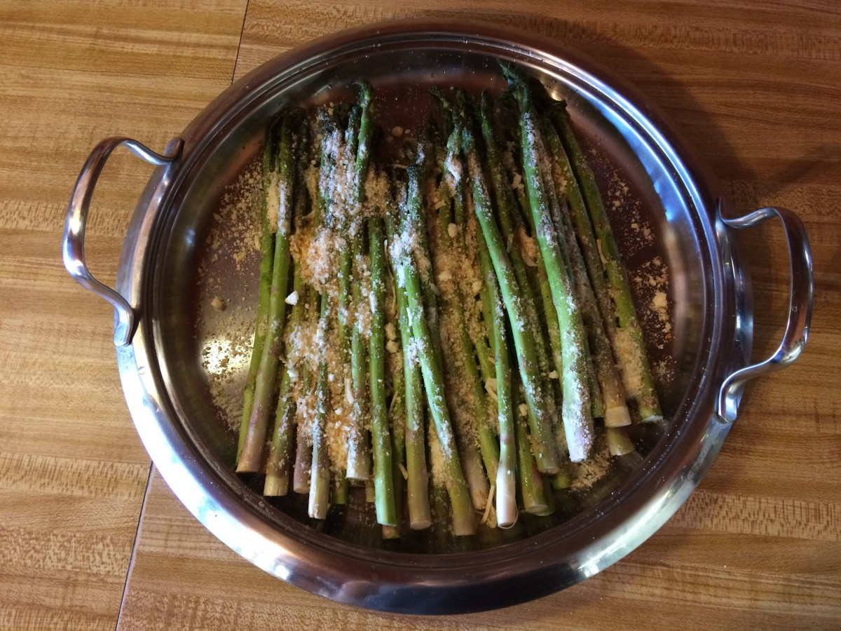 The asparagus after sprinkling with the spices and cheese.