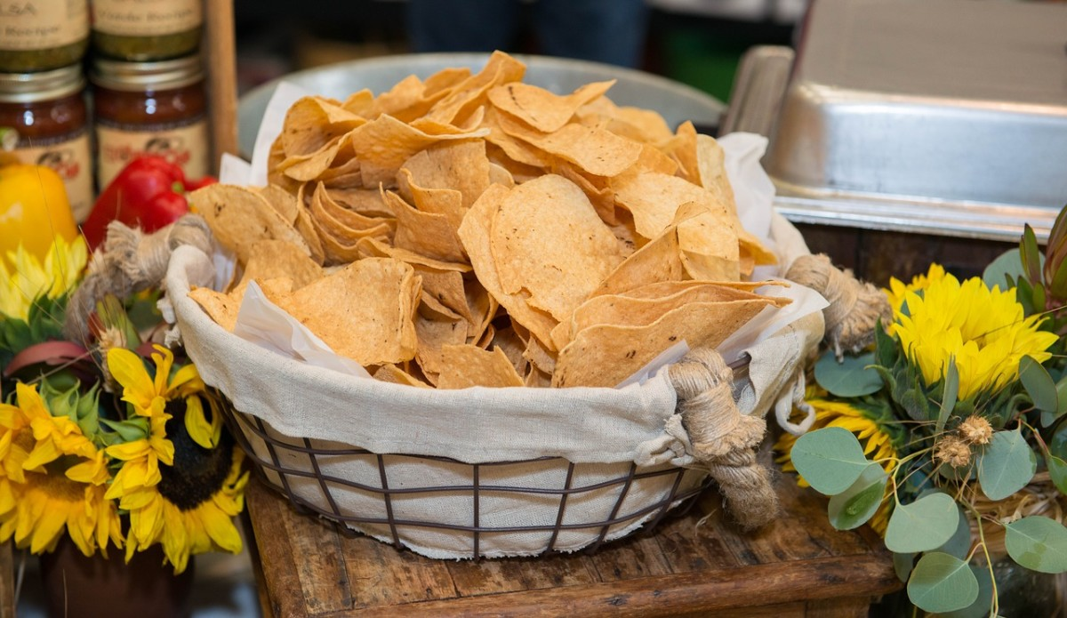 Baked, multi-grain tortilla chips or veggie chips in moderation can satisfy your mouth's yearning for extra crunch and texture.