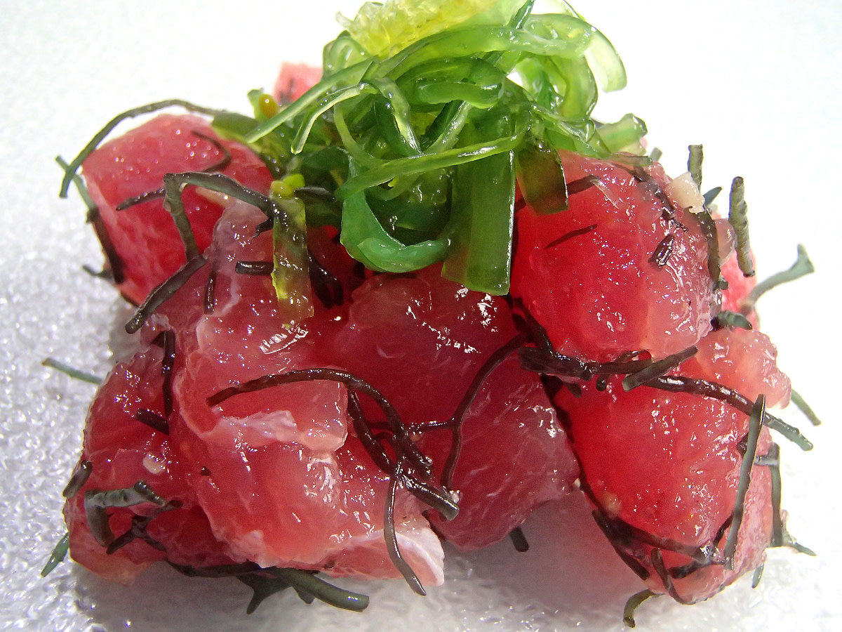 Enjoy poke with a bowl of rice for a fulfilling meal.