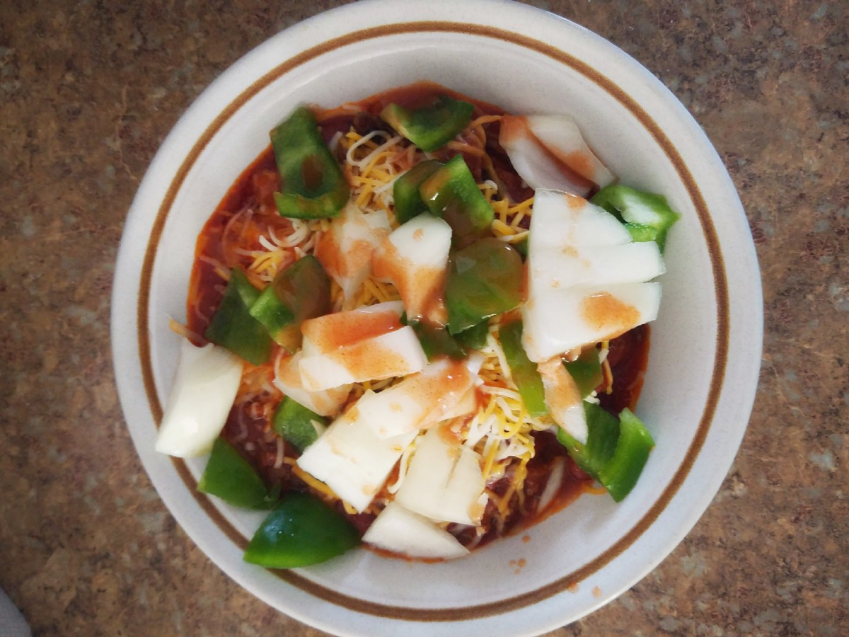 Some cheese, onion, green peppers, and a little hot sauce will spice up your chili.