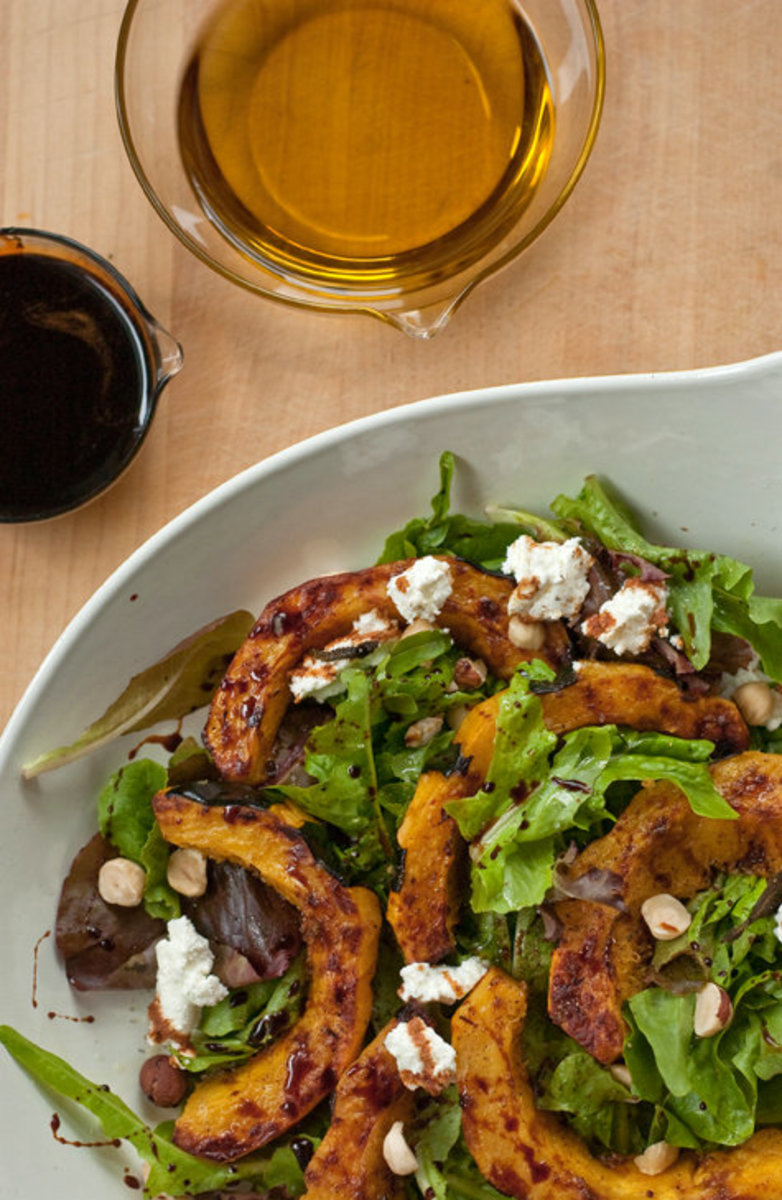 Roasted Squash Over Arugula With Goat Cheese and Hazelnuts Salad
