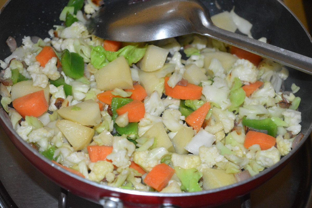 Sprinkle some water if needed. Cook till veggies become soft yet retain crunchiness.