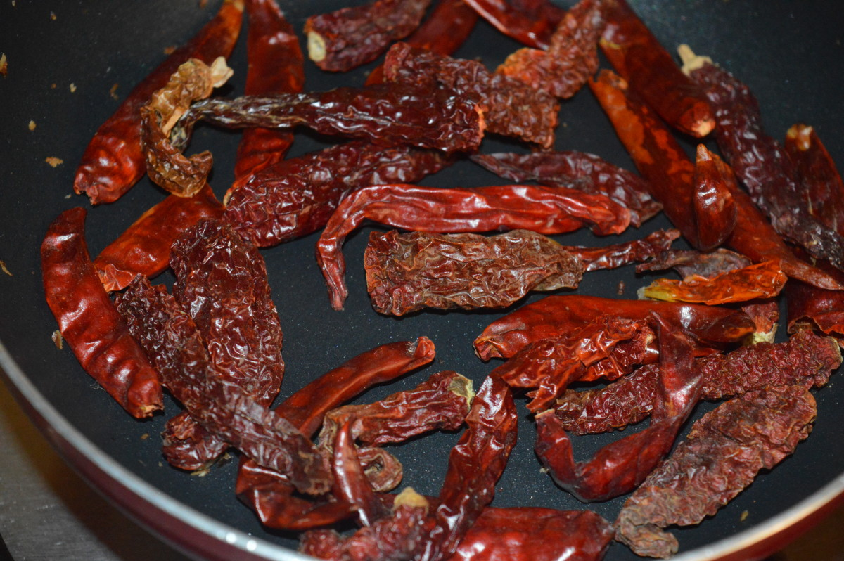 Step two: In the same pan, dry saute red chilies till they become a bit crispy. Add it to the plate.