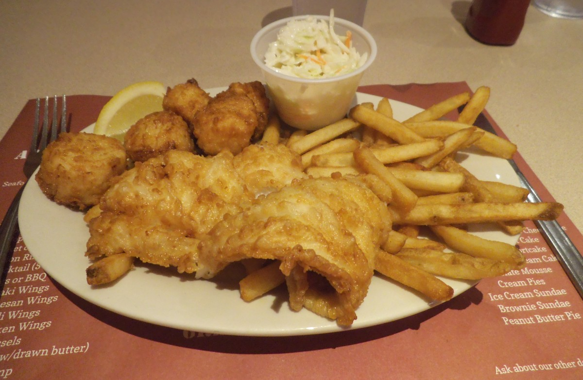 In New England in the summer, it's hard to resist a bowl of creamy clam chowder, followed by fried clams or fried haddock. Ask if they have broiled seafood on the menu. You can also split some fried seafood with a friend to minimize the damage.