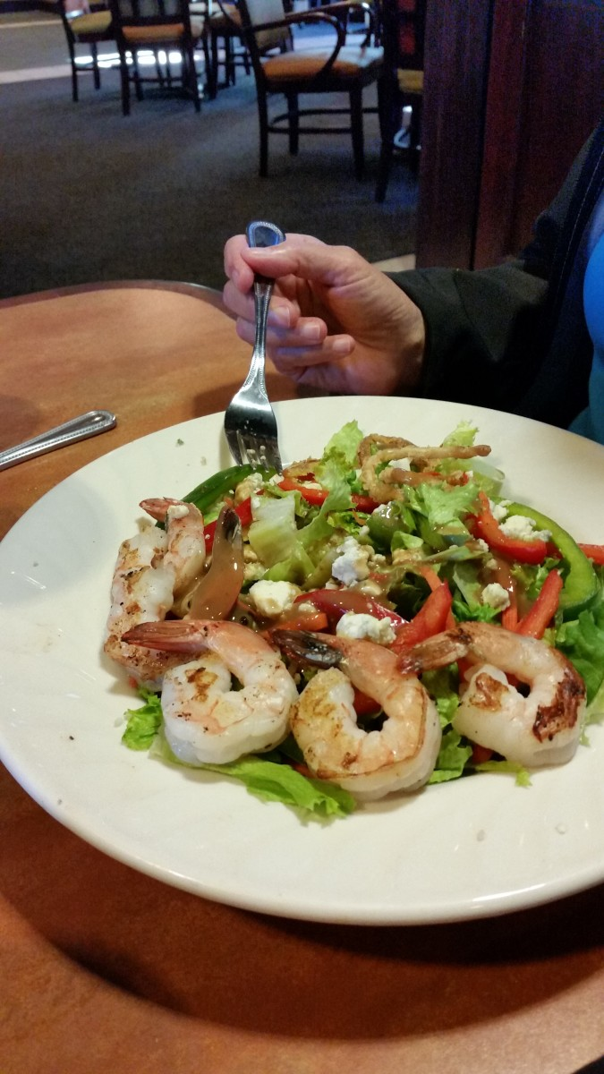 A salad that feels luxurious and fills you up without lots of calories. Shrimp, a small amount of feta cheese, and lots of vegetables. Wonderful.