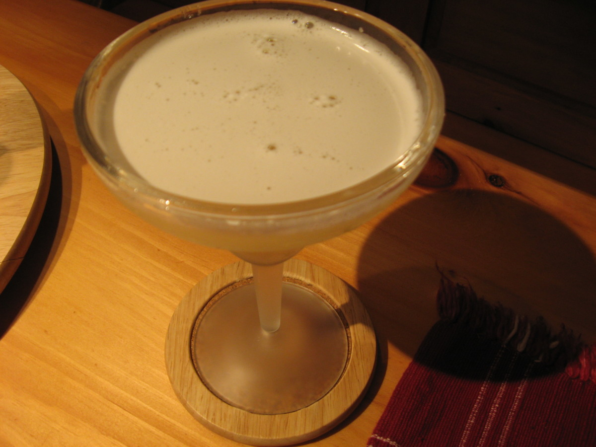 A glass of white wine would have been a better choice than this sugary margarita. If it's lunch time, I usually opt now for water with a lemon wedge. It's the evening meal that tempts me to order a fancier beverage.