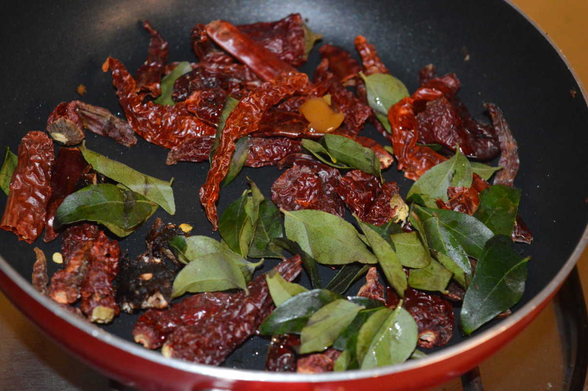 Step four: Saute broken red chili, curry leaves, and hing/asafoetida in very little oil till they become crispy.