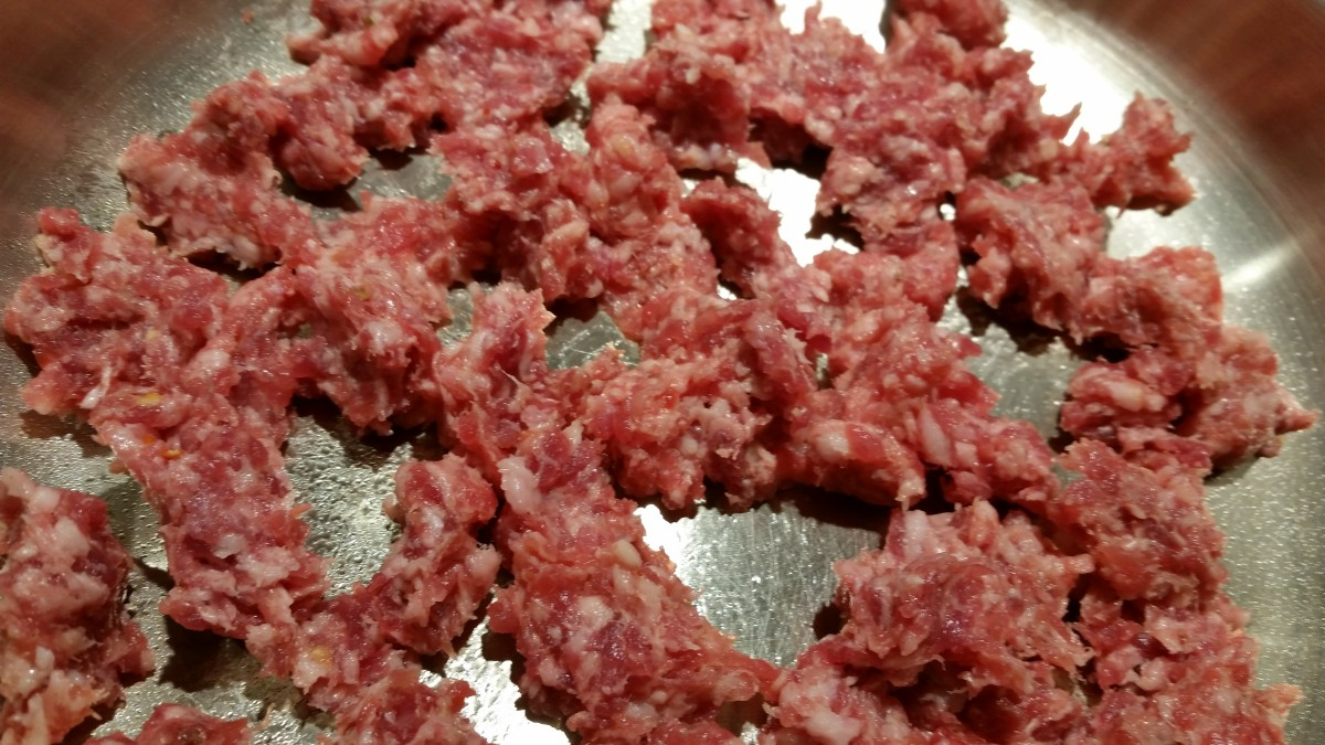 Tear or pull apart sausage and begin cooking in skillet.  Be sure center of sausage has lost its pink color and is fully cooked.
