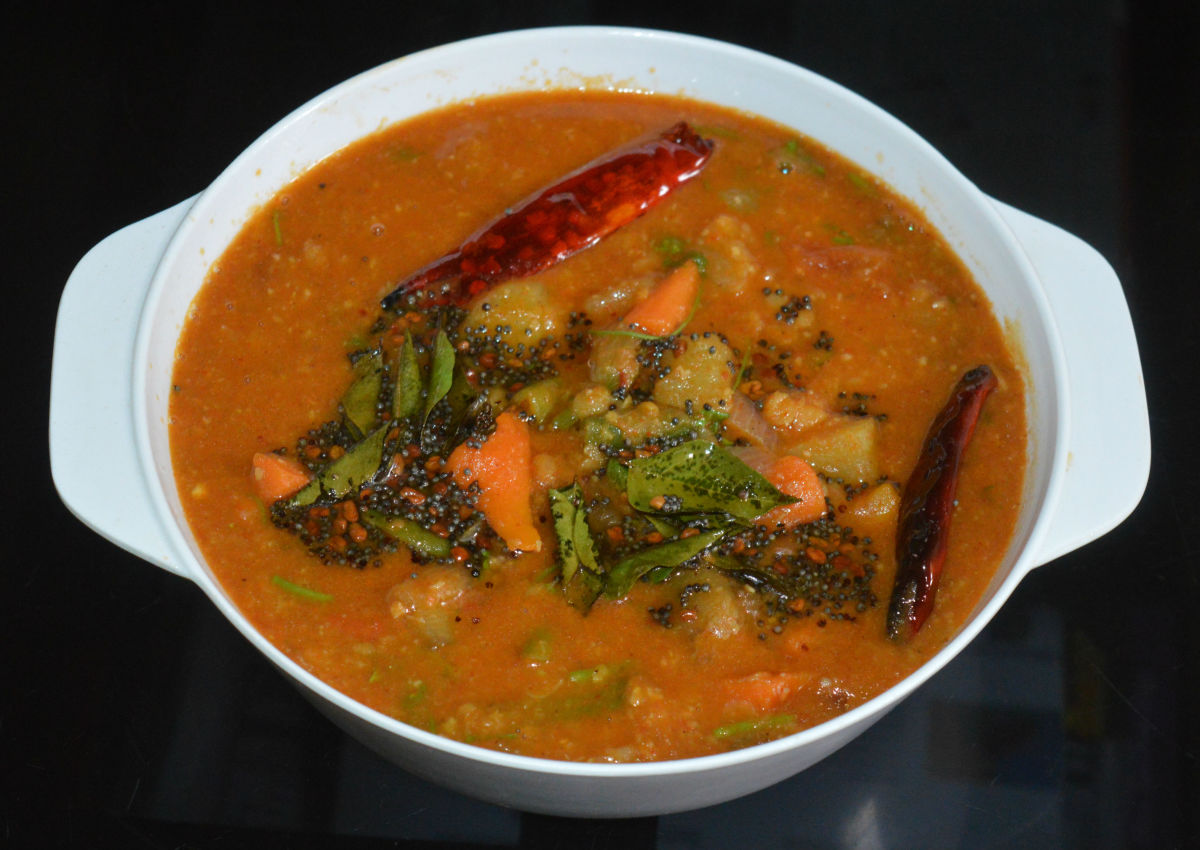 Step seven: Now, transfer the sambar to a serving dish. Add tempering as per instructions. Mix well while serving. Enjoy eating this spicy sambar with rice, dosa, or idli. You can serve this as a side dish for any type of vegetarian main course.
