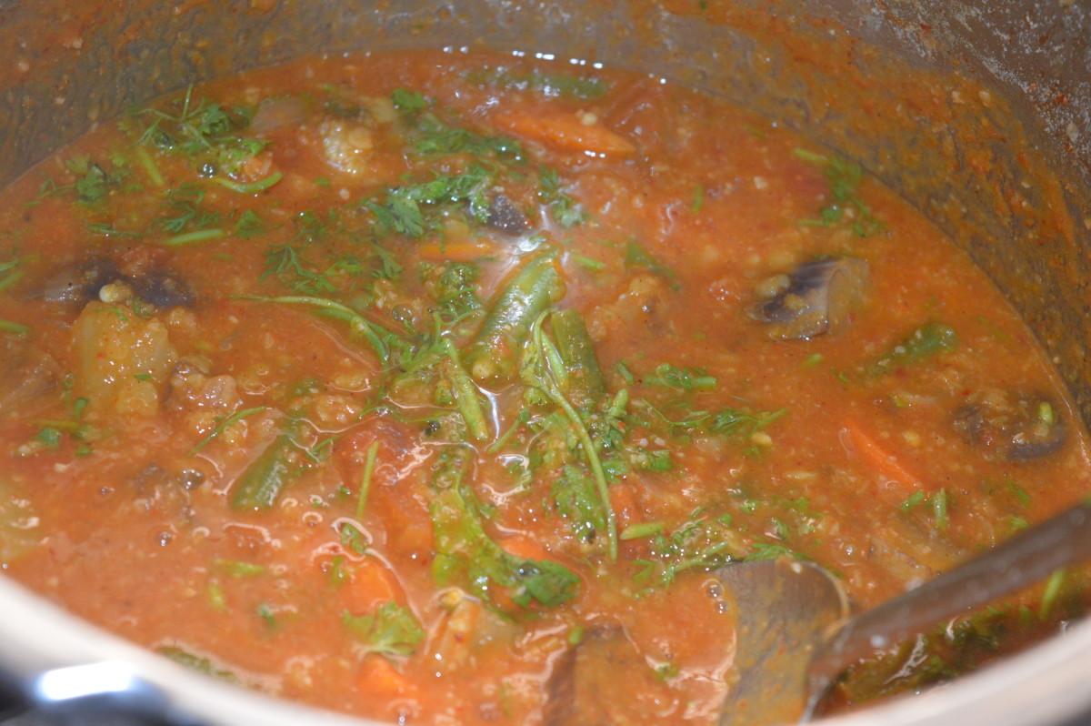 Add finely chopped fresh green coriander. Stir well.