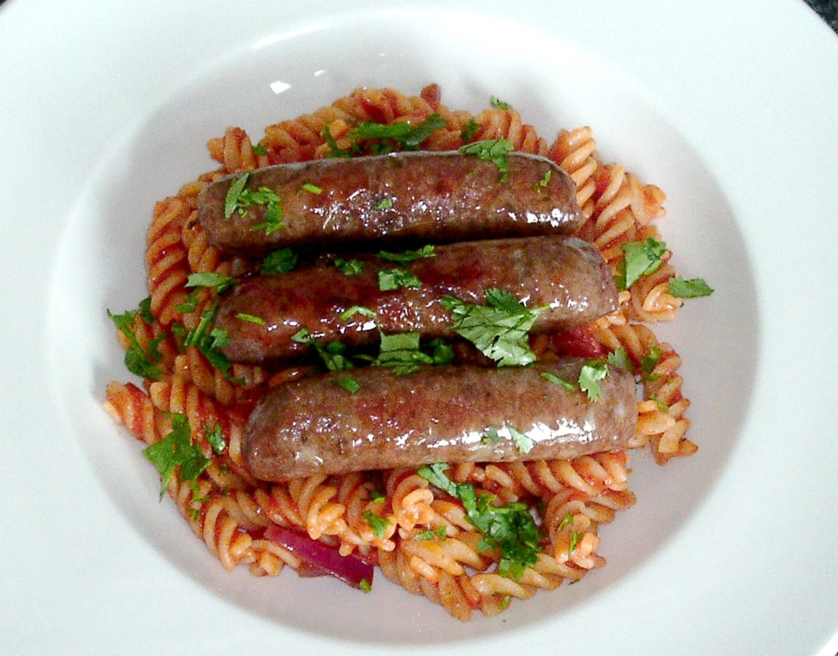 Venison Sausages Served on a Bed of Fusilli Pasta in Tomato Sauce