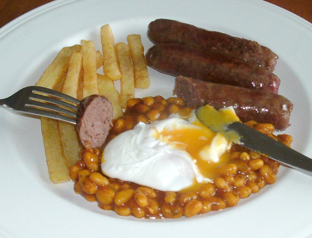 Venison sausages With Poached Egg, Chips and Spicy Beans