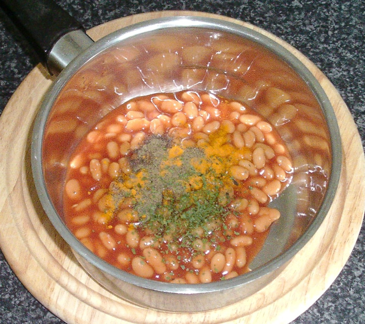 Additional seasonings are added to baked beans in tomato sauce