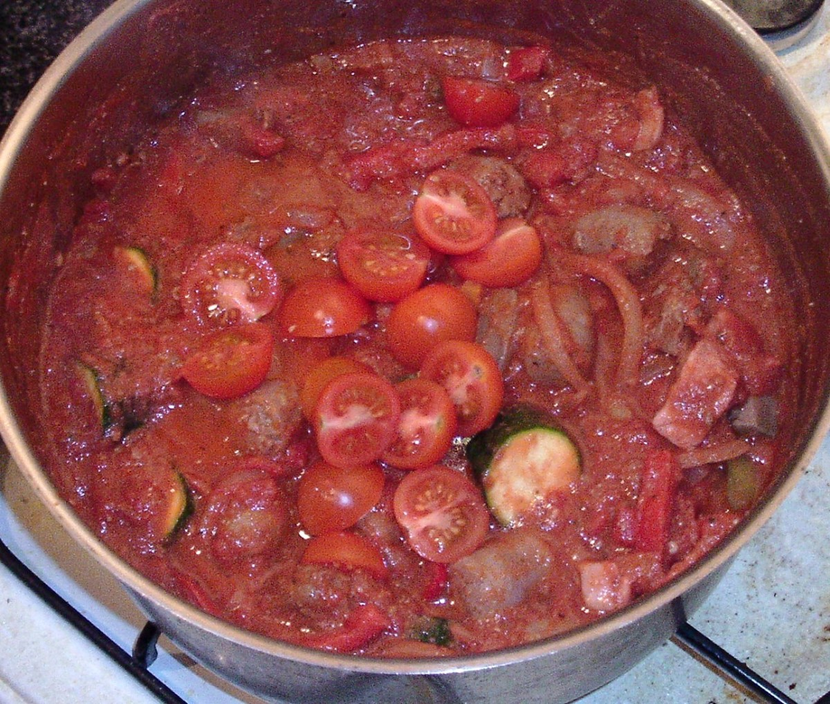 Halved cherry tomatoes are added to stew half way through cooking