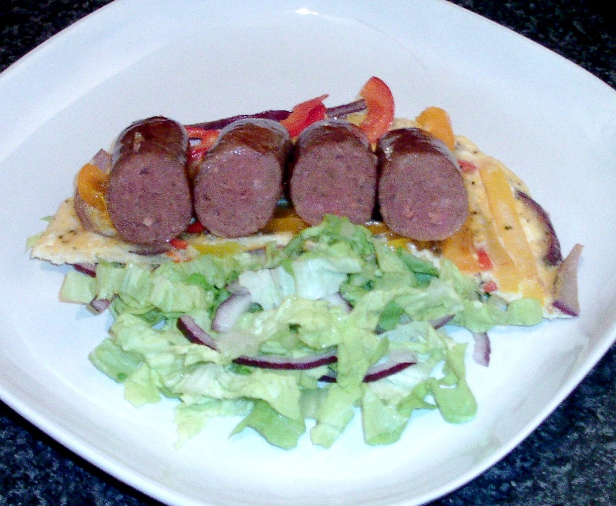 Halved venison sausages are laid on tortilla base