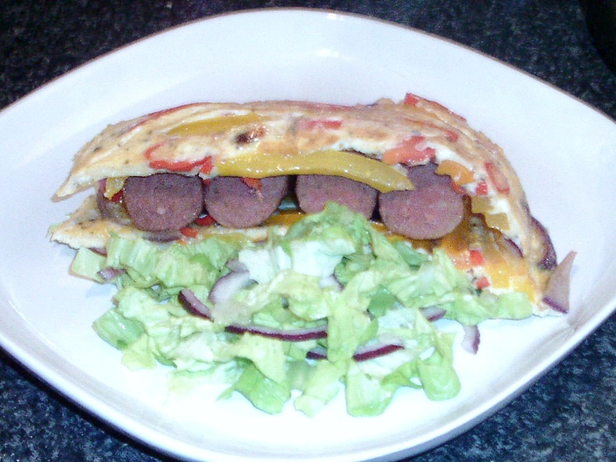 Venison sausages are sandwiched between the two halves of a spicy tortilla
