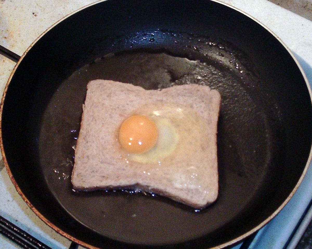 Egg is carefully poured in to a hole in the frying bread