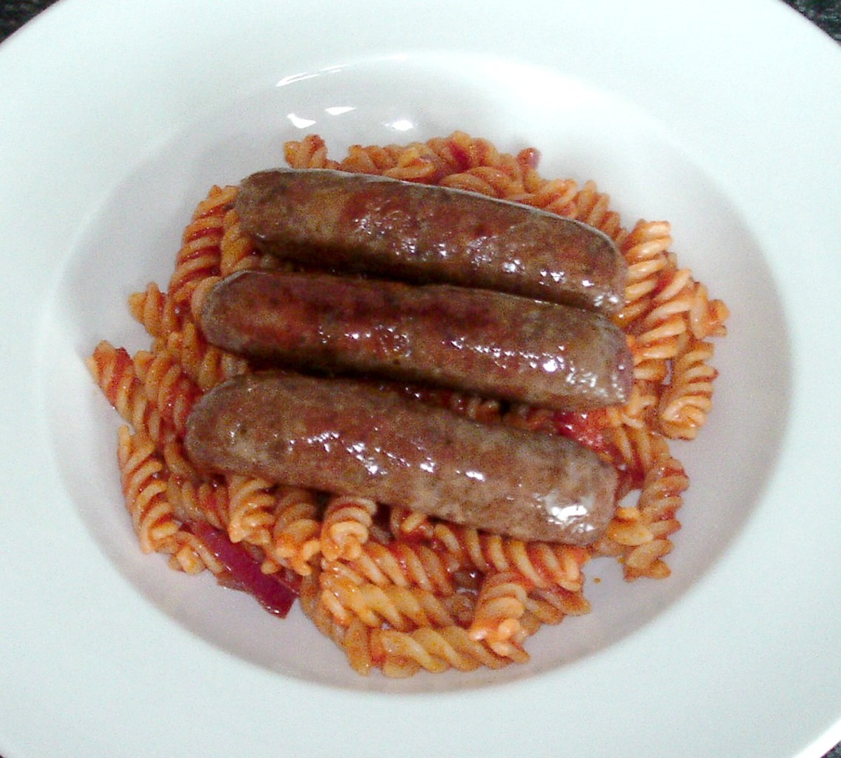 Venison sausages on fusilli pasta