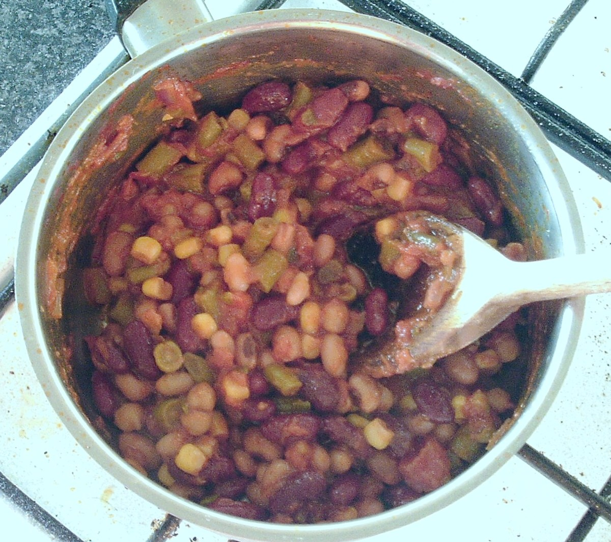beans are stirred in to reheated tomato sauce