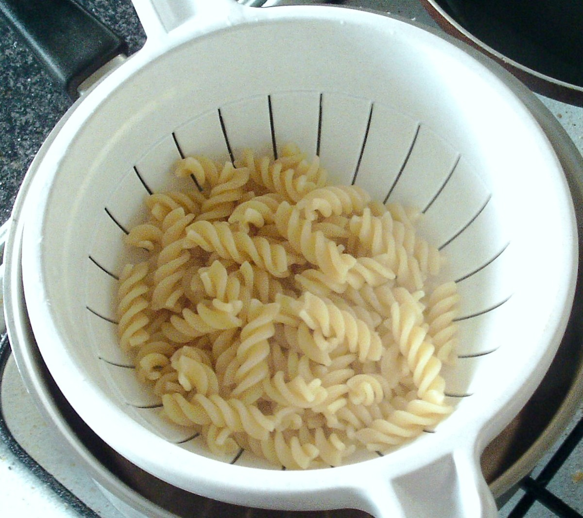 Fusilli pasta is drained
