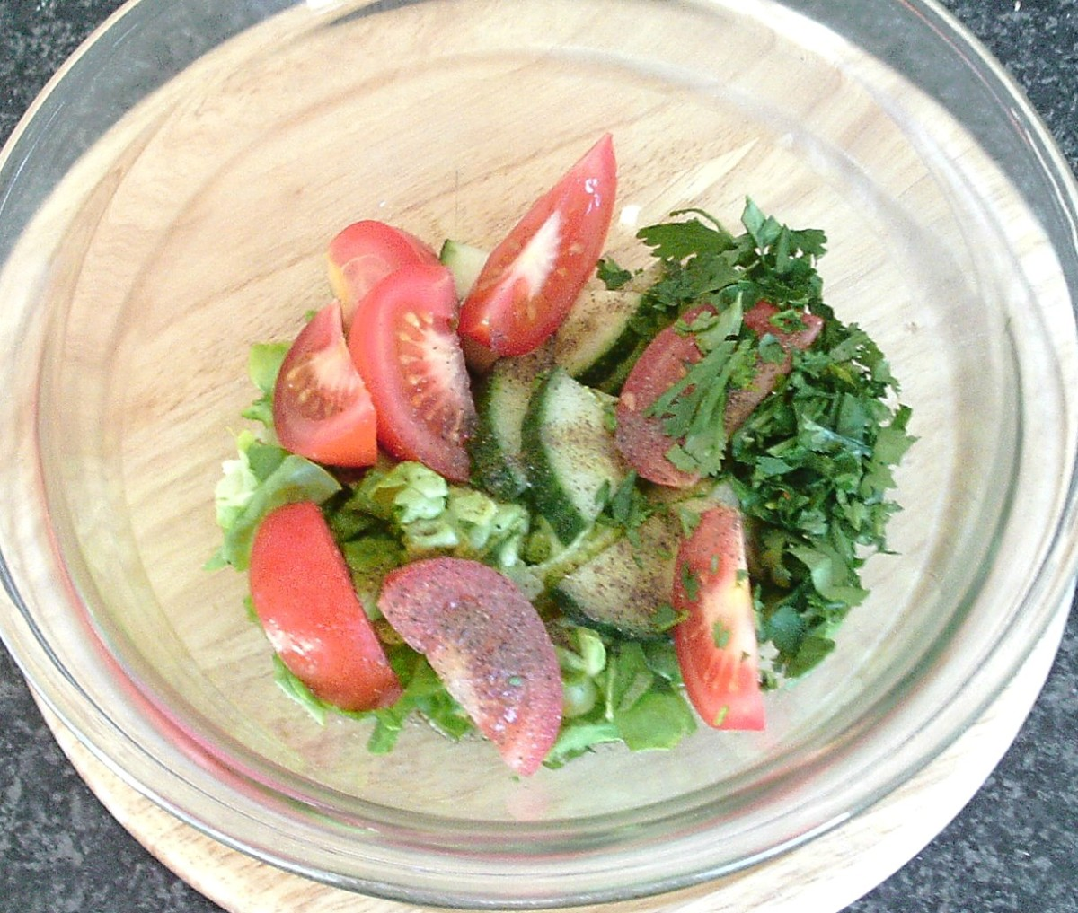 Salad ingredients are added to dressing