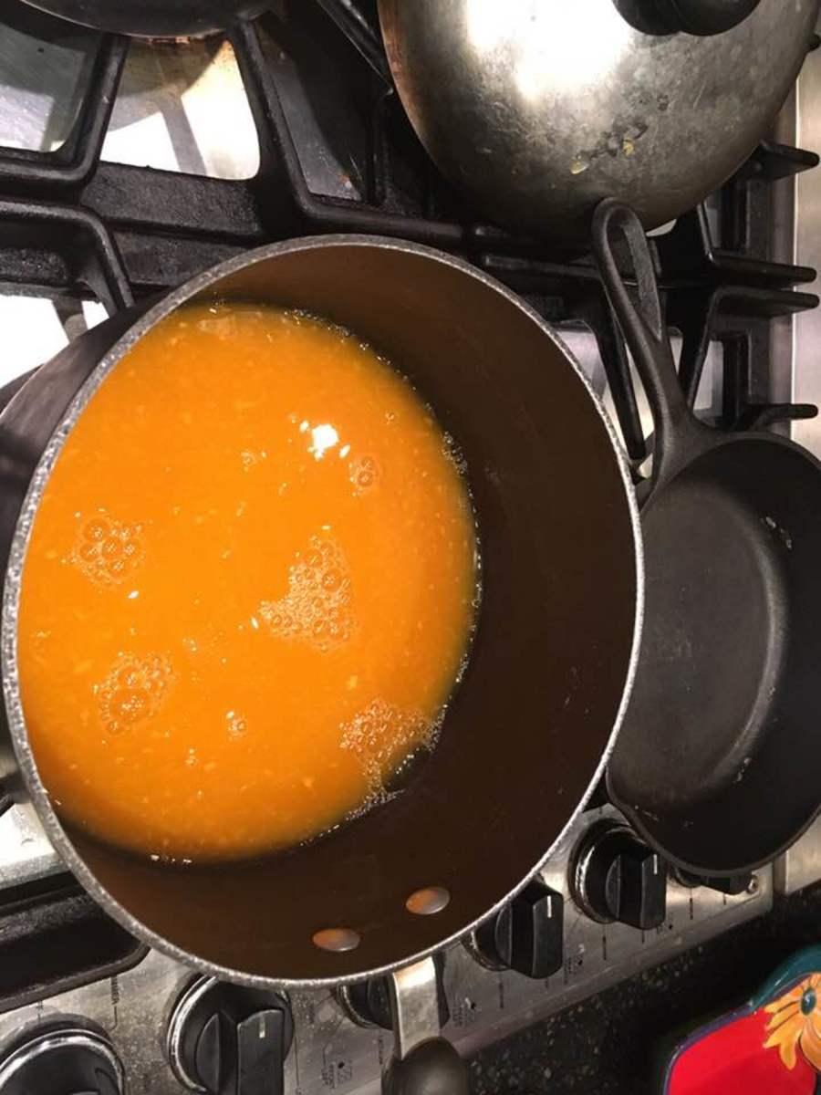 Heat the juice in a saucepan.