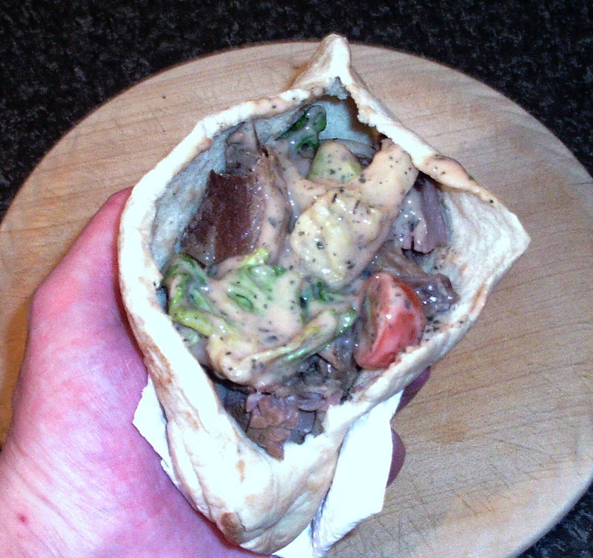 Last of the salad is made to fill the pitta pocket