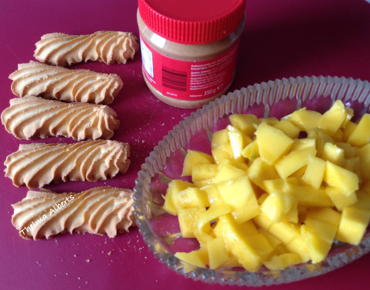 Biscuits, peanut butter, and mango cubes.