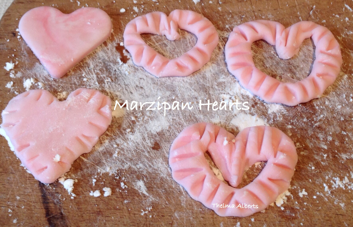 Making hearts out of marzipan. Some edges were decorated by the use of a cake fork.