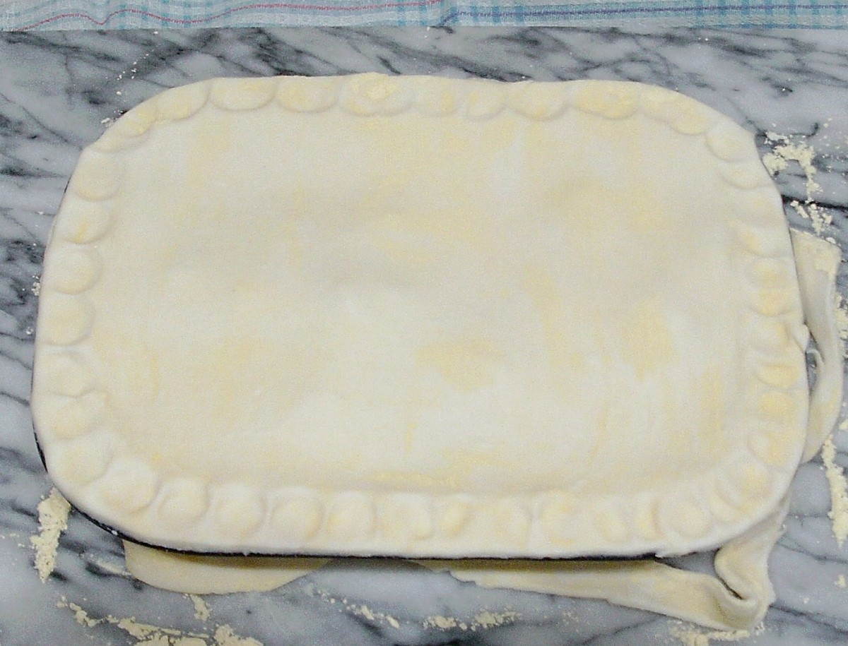 Pastry is fitted on pie dish and crimped
