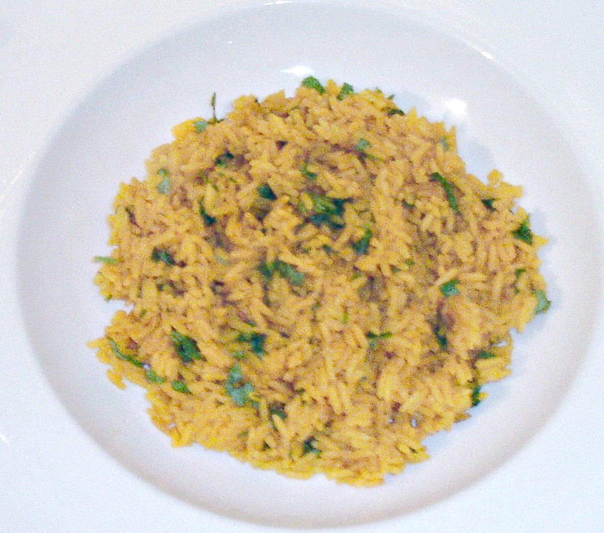 Turmeric rice is arranged to serve as a bed for the ostrich